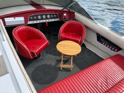 A boat sitting on top of a red chair
