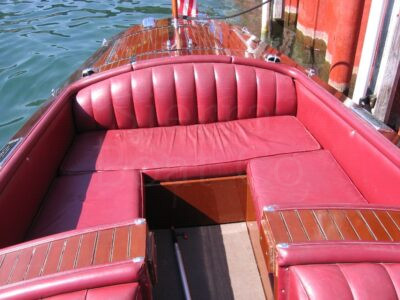 A boat that is sitting on a red bench